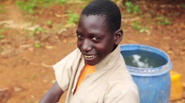 Vianney and his family have access to safe water through a gravity-fed water system we funded in partnership with World Vision and AusAid.